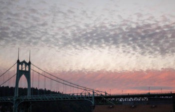 St. Johns bridge at dusk, with pink clouds in the background.