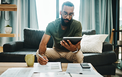 young man reviewing finances at home