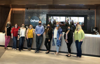 OnPoint employees line up inside the OnPoint's new Sherwood Branch. with masks.