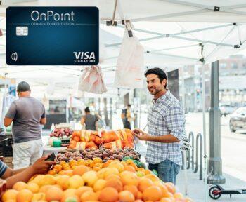 Man buying oranges in outdoor market