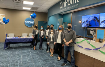 Team members of the OnPoint 67th & Glisan branch line up to celebrate the opening of their new branch.