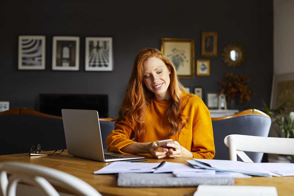 woman taking action changing passwords and reviewing documents