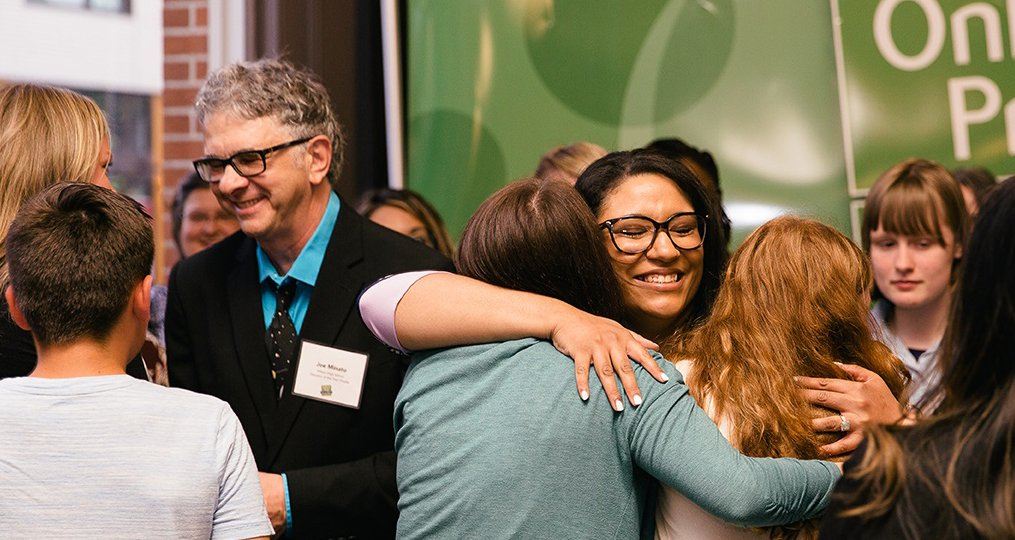 Francesca Aultman OnPoint Prize Award Announcement hugging students