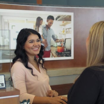 Araceli-Gretting-at-the-Branch-Member-Services-Desk