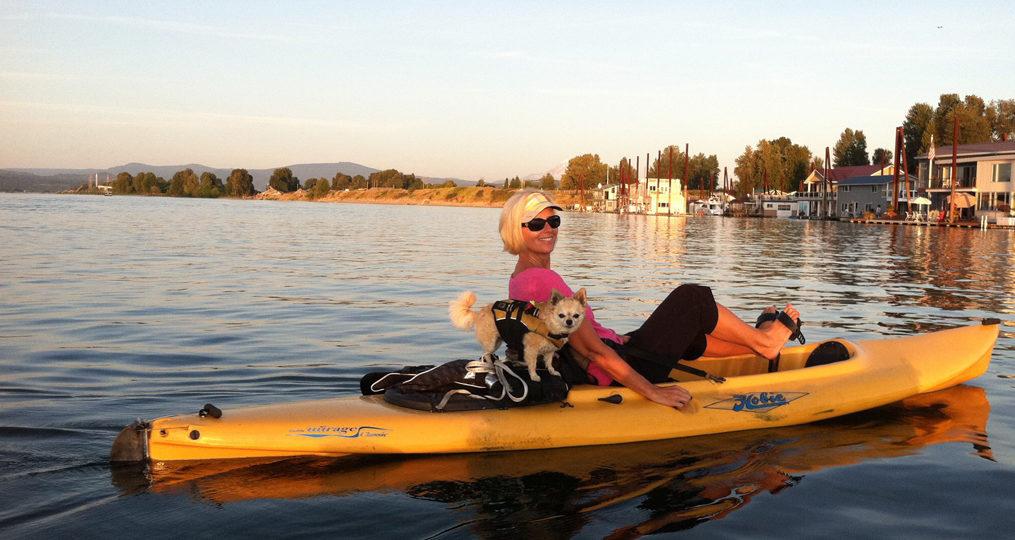 Terri Hunter employee spotlight_Terri kayaking with her small dog