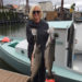 Terri Hunter employee spotlight_fishing and holding two large fish