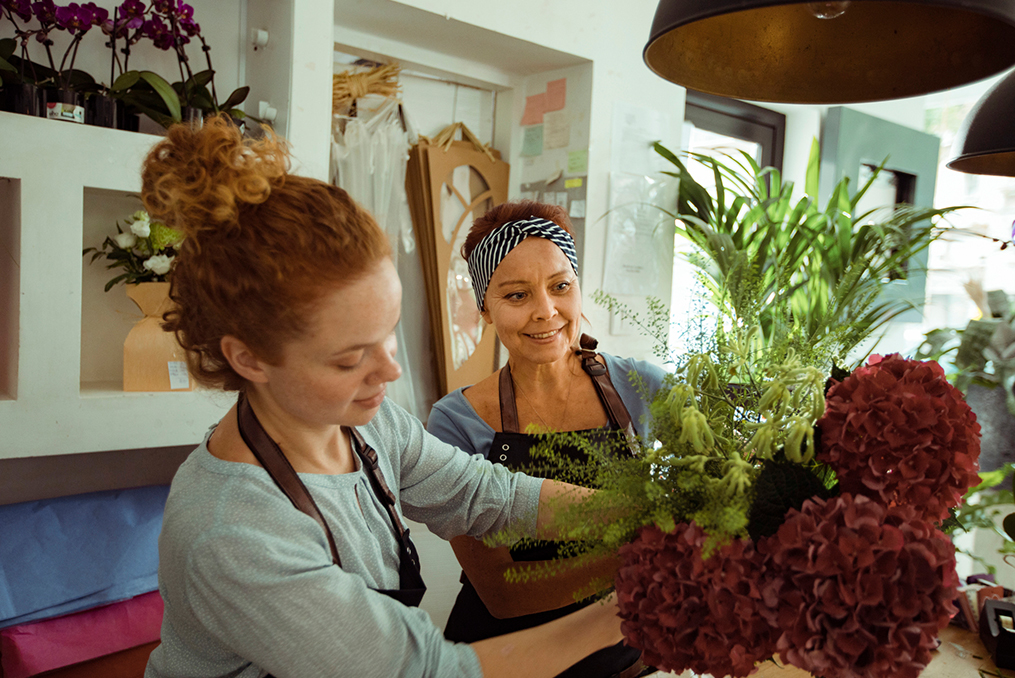 Flower Shop Owner working with her employee on a customer order