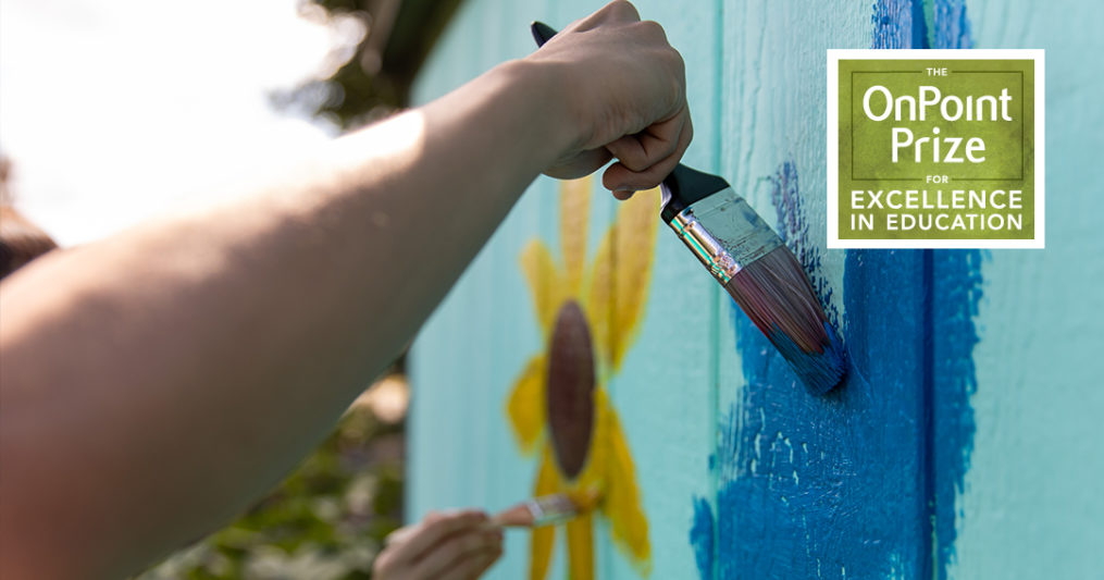 Help Decide the Winner of OnPoint's $5,000 Community Builder Award-hand painting a mural in a garden