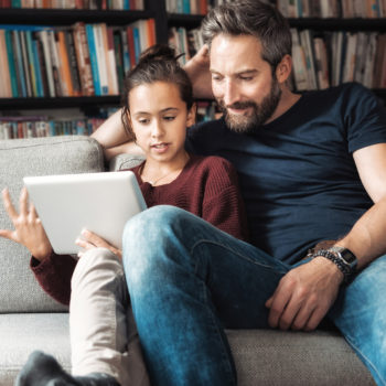 10 Tips to Share with Your Kids About Personal Cybersecurity_Father and daughter talking about cybersecurity