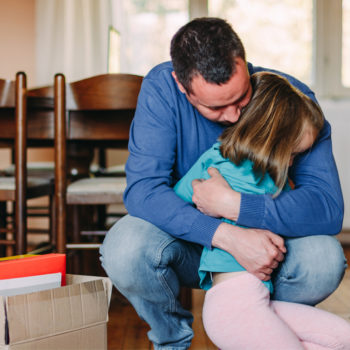 5 Steps to Take If You Lost Your Job in Oregon State_Man hugging his daughter after losing his job