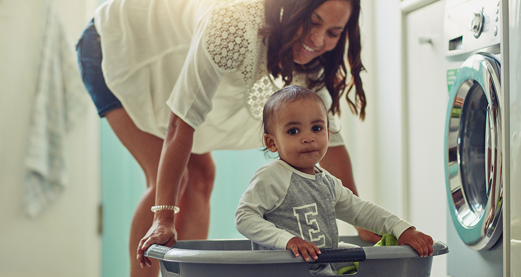 5 financial considerations to make when you are growing your family_boy in laundry basket