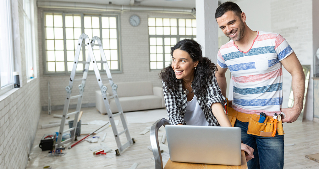 7 Home Improvements That Can Increase the Value of Your House in Oregon_woman and man looking at laptop while remodeling home