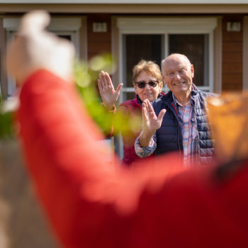 Catch the Wave of Generosity on GivingTuesdayNow_An elderly couple receiving groceries from their neighbor