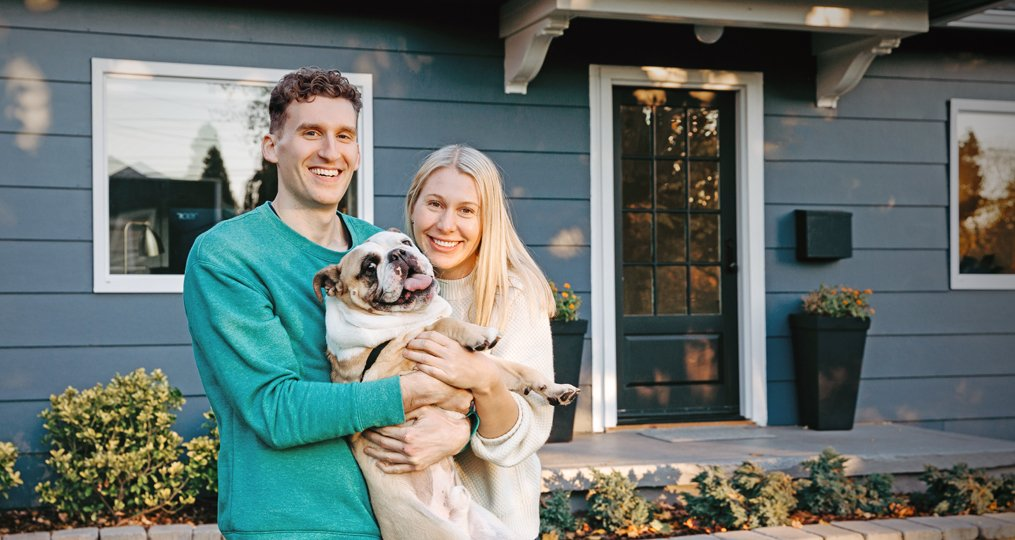 Employee Spotlight with Dannielle Stuart_Dannielle and Eric in front of their house