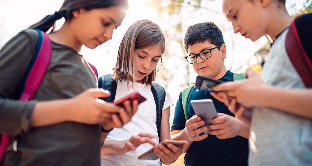 Essential Tips for Securing Your Family's Mobile Devices_Kids using smartphones after school