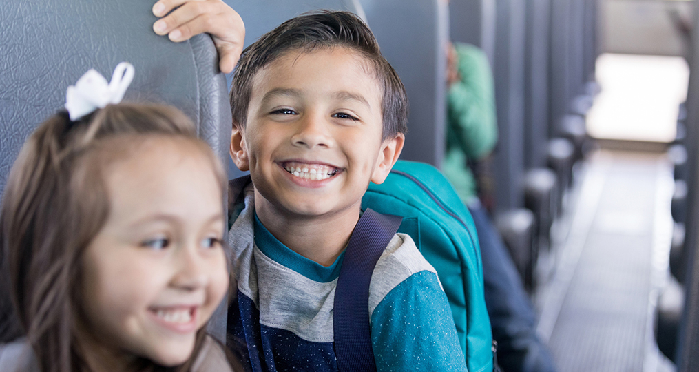 How to Get the Most From Your 529 Plan_young boy smiling on the school bus