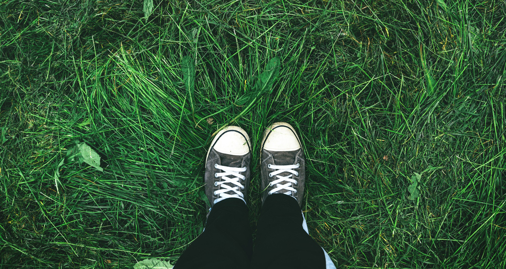Mollala High's Friendship Courtyard Inspires Amid COVID-19_sneakers on green grass