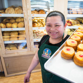 OnPoint Employees Direct $91,000 to Local Non-profits_woman holding a pan of pastries
