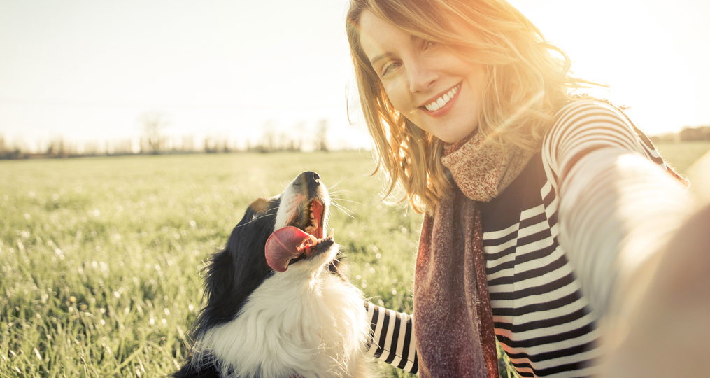 Personal Loans-What Your Options Are and When Should You Get One_Smiling lady taking selfie with her dog