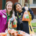Portland State University volunteers holding up carrots_Oregon Food Bank Refer a Friend