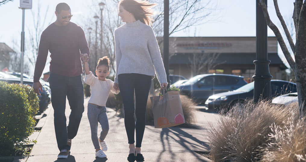Savings tips you can bank on blog size_Family walking in a parking lot