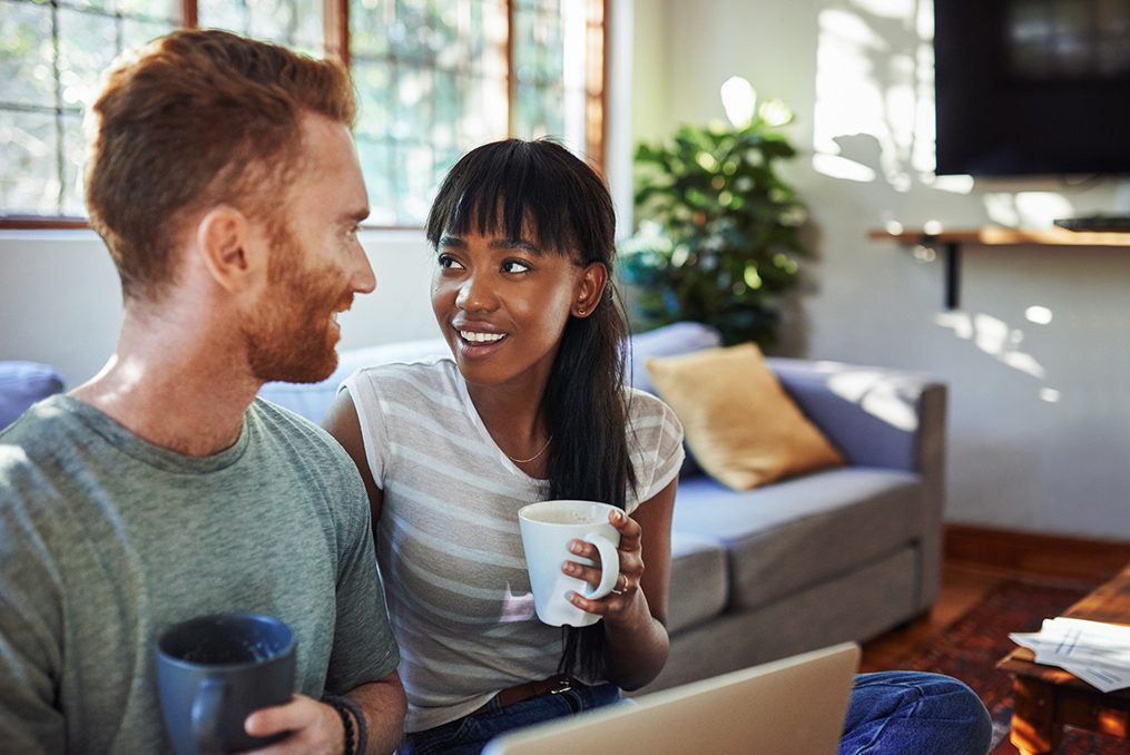 The difference between good and bad debt_Man and woman discussing finances and drinking coffee