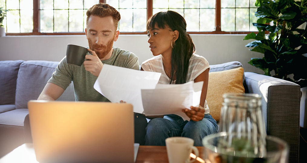 The difference between good and bad debt_Man and woman discussing finances together