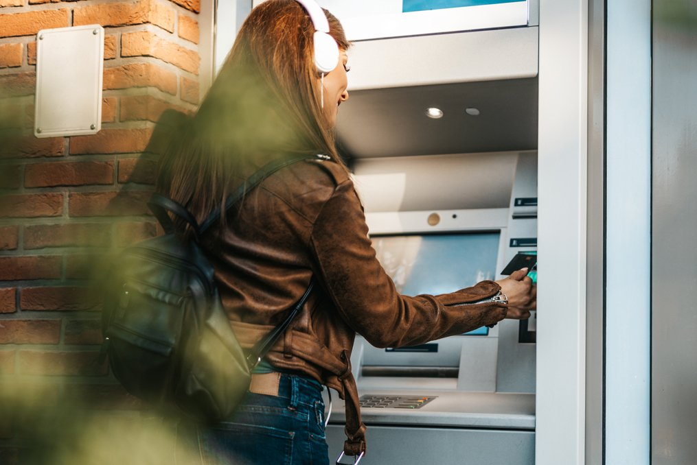 How to avoid ATM fees_woman using ATM