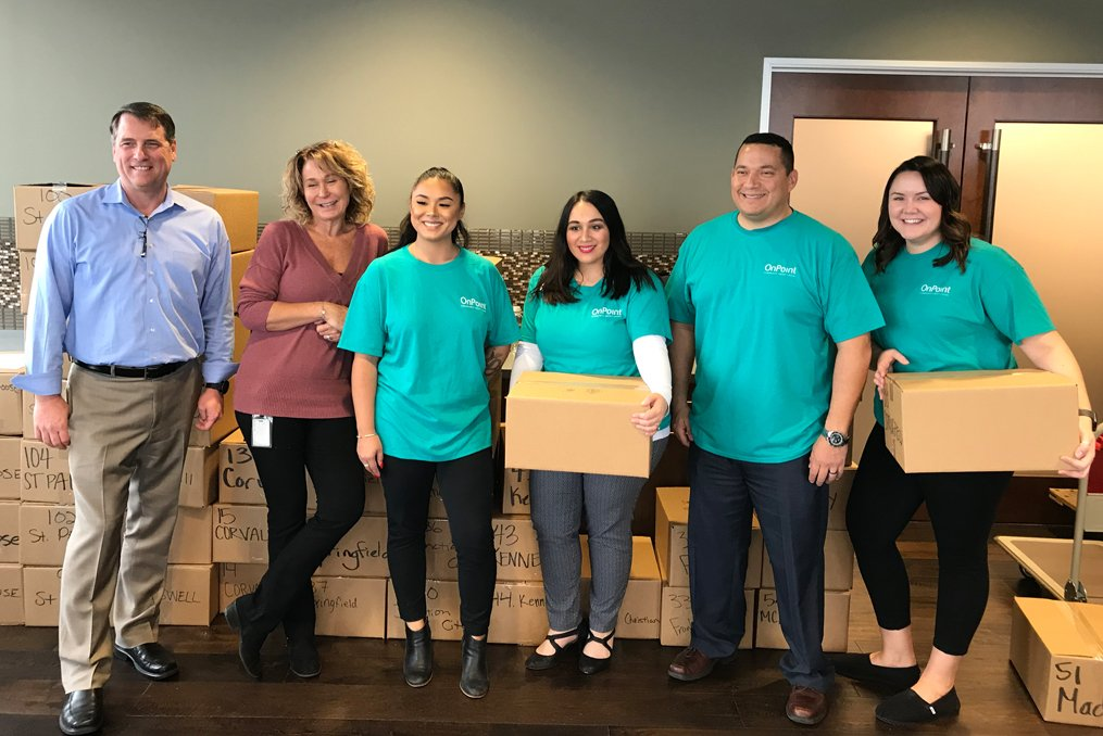 OSAA Foundation Student Assistance Program_OnPoint employees with donation boxes at Montgomery Park