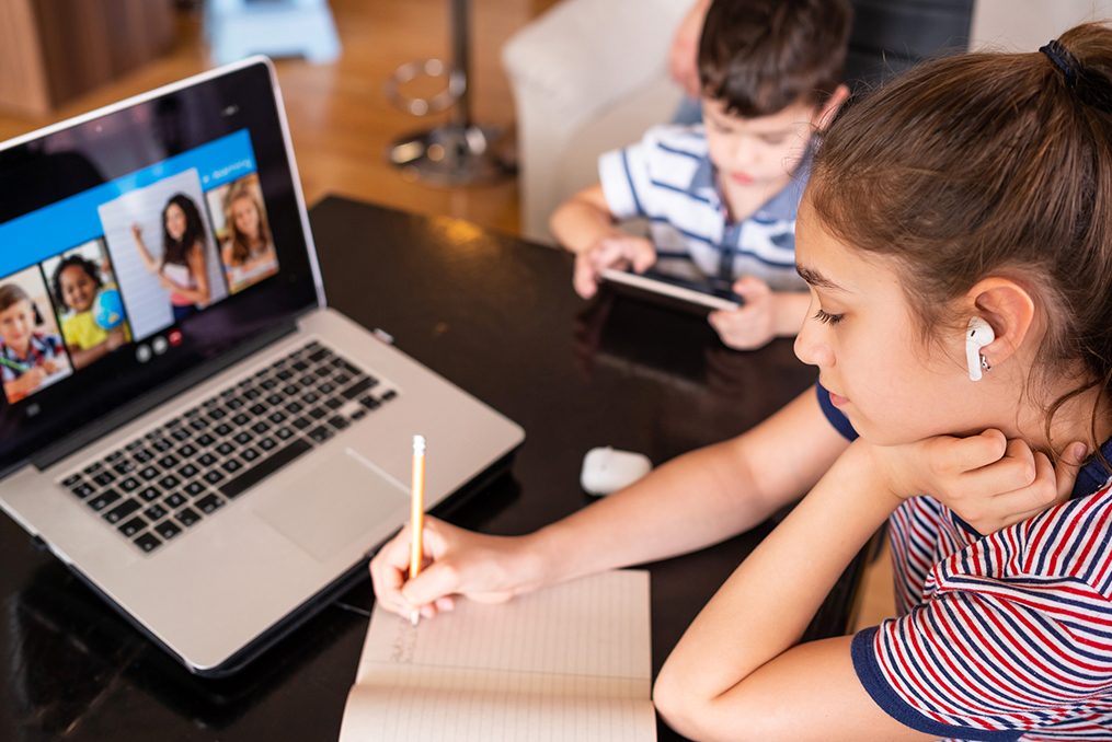 The Biggest Cybersecurity Questions for Parents_daughter and son using laptop and tablet