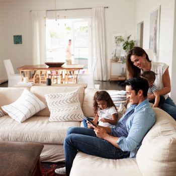 What You Should Consider When Buying Life Insurance_Young family reviewing insurance options in their living room