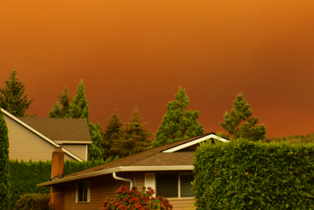 emergency preparedness and disaster planning in the pacific northwest_fire clouds over rooftops