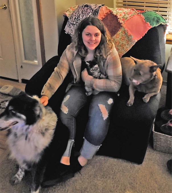 employee spotlight with Angel Houston_with dogs