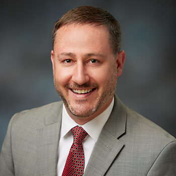 Studio portrait of Will Burton, OnPoint Commercial Relationship Manager
