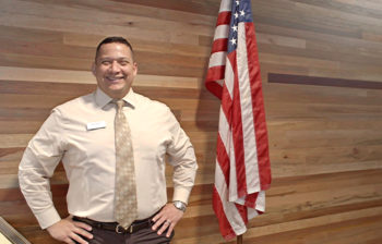 Nick Styles military veteran photo with American Flag in OnPoint HQ Lobby_1049x670