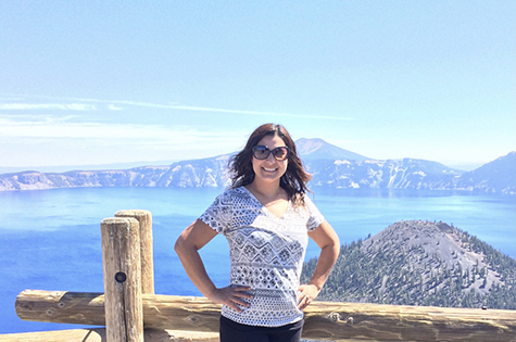 Marlen posing in front of a scenic mountain and lake view in the pacific northwest crater lake