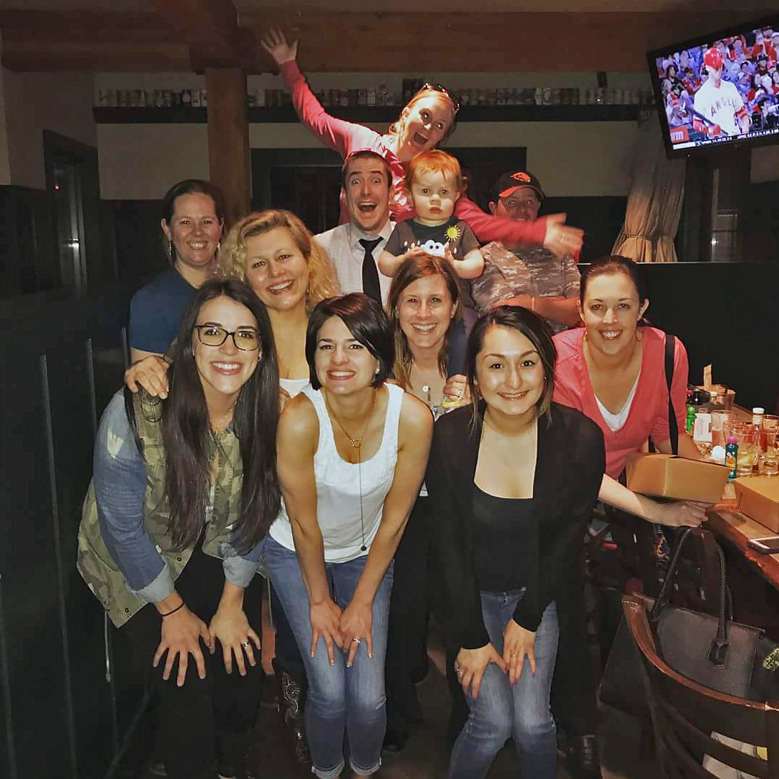 Alex Phillips with coworkers on bingo night in Bend Oregon