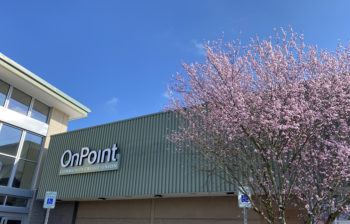 Exterior of East Gresham OnPoint Branch at Fred Meyer with cherry blossom tree in foreground