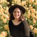 Chelsea Johnson headshot among a field of flowers