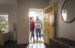 couple walking through the door of their home