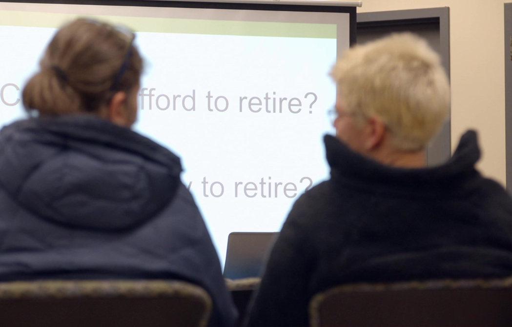 two attendees sitting and talking at an OnPoint Financial Services Seminar