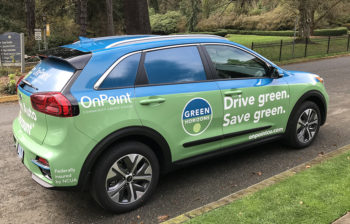 Kia electric vehicle with OnPoint Green Horizons logo and branding.