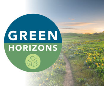 Field of wild yellow flowers with OnPoint's Green Horzons logo