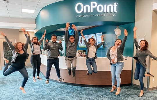 Team members of the OnPoint Johnson Creek Branch line up to celebrate the opening of their new branch.