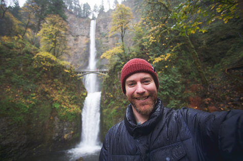 Man standing in front of Multnomah Falls