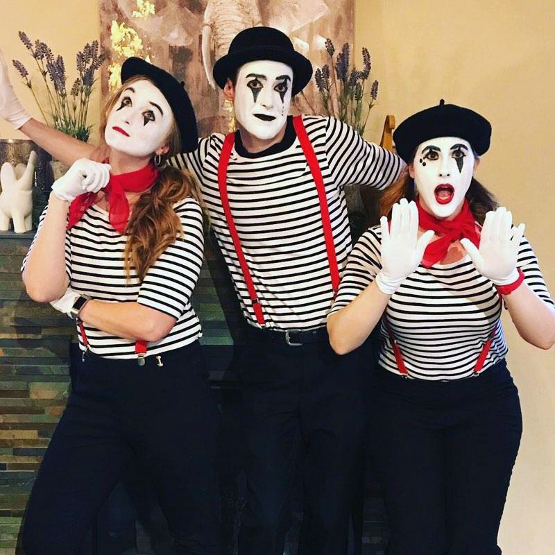 Alex and team dressed up as Mime's for an annual charity spelling bee.