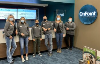 Team members of the OnPoint Salmon Creek Branch line up to celebrate the opening of their new branch.