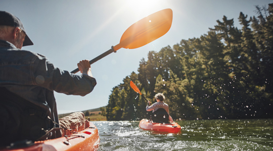 Senior couple kayaking in a lake