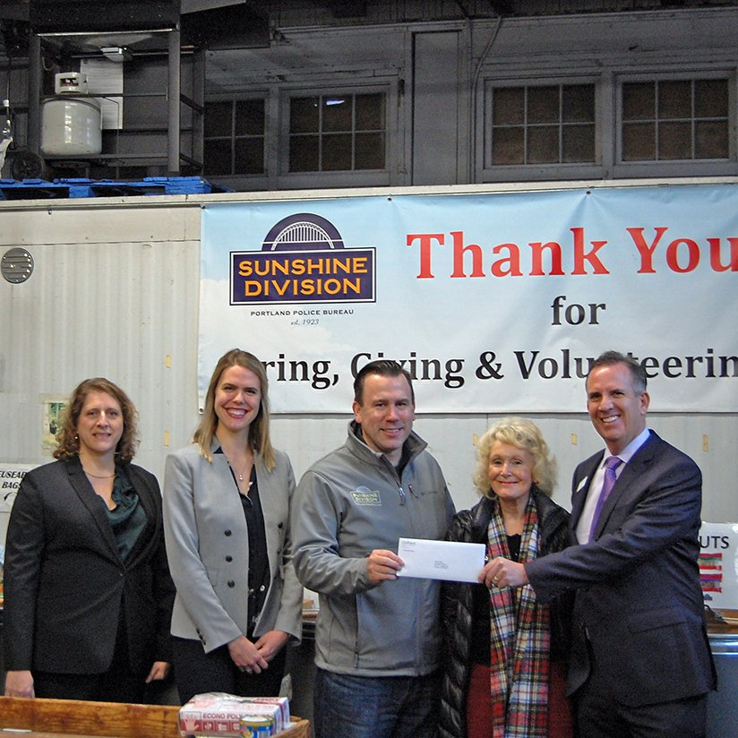Spreading Holiday Cheer Through Our Employee Giving Program_Sunshine Check Presentation_square