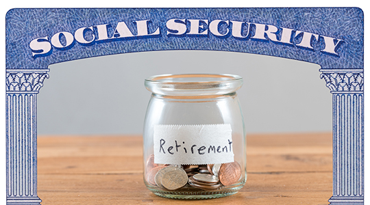 Loose change inside glass jar to represent retirement savings for Social Security